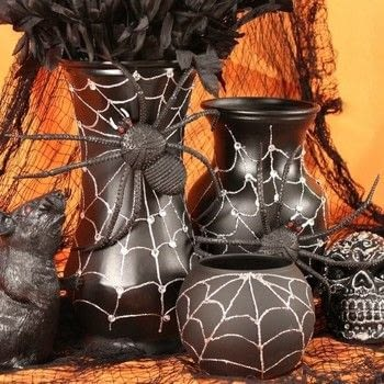 Recycle old flower vases to make funky Halloween decor! .  Free tutorial with pictures on how to make a Halloween decoration in under 60 minutes by spraypainting, decorating, and embellishing with hot glue gun, gems, and toy. How To posted by Mark Montano.  in the Decorating section Difficulty: Easy. Cost: Cheap. Steps: 2