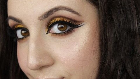 This is a very dramatic look for those of you daring enough to rock this bright yellow!  This look, although very dramatic, can be toned down to your liking!  By using a different color, by not using bottom false lashes or by not using liquid liner, this look can become much more wearable and easy to pull off!  Remember that makeup washes off.. have fun with it!  .  Free tutorial with pictures on how to create a cut crease eye makeup look in under 30 minutes by applying makeup with blending brush, eyeshadows, and eyeliner. Inspired by yellow. How To posted by Nicole N.  in the Beauty section Difficulty: 4/5. Cost: 3/5. Steps: 1