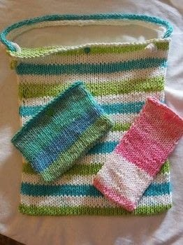 Keep organized with this pretty summer tote! .  Free tutorial with pictures on how to stitch a knit or crochet bag in 7 steps by knitting with cotton, snaps, and double pointed knitting needles. How To posted by Renee D.  in the Yarncraft section Difficulty: Easy. Cost: Cheap.