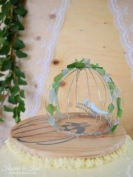 Birds of a feather.. marry together! .  Free tutorial with pictures on how to make decorative tablewear in 6 steps by decorating with wood, glue gun, and silver wire. Inspired by weddings, birds, and cake. How To posted by Flourish & Knot.  in the Other section Difficulty: 3/5. Cost: 3/5.