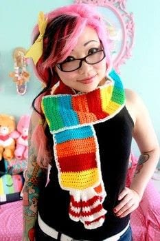 This cute and colorful crocheted scarf will turn you into a treat! .  Free tutorial with pictures on how to knit or crochet a stripy scarf in 7 steps by crocheting with worsted yarn, hook, and scissors. Inspired by candy. How To posted by Twinkie Chan.  in the Yarncraft section Difficulty: Simple. Cost: 3/5.