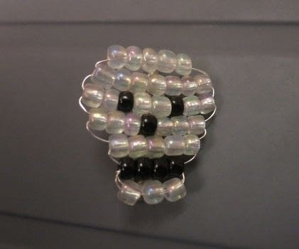 Quick beaded skull .  Make a beaded brooch in under 20 minutes by jewelrymaking, beading, and wireworking with seed beads, brooch, and seed beads. Creation posted by Gemma T.  in the Jewelry section Difficulty: Simple. Cost: Cheap.