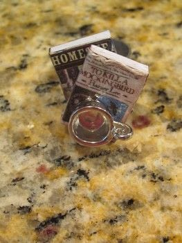 Take your books and tea everywhere! .  Make a charm ring in under 30 minutes by papercrafting with glue, book, and cups. Inspired by books. Creation posted by Colleen .  in the Jewelry section Difficulty: Easy. Cost: Cheap.