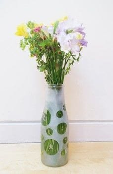 Give a vase a simple crafty makeover! .  Free tutorial with pictures on how to etch an etched vase in under 15 minutes by etching with vase, sticker paper, and hole punch. How To posted by Cat Morley.  in the Home + DIY section Difficulty: Simple. Cost: Cheap. Steps: 8