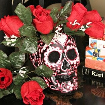 Make a sugar skull vase for Halloween (or all year) .  Free tutorial with pictures on how to make a vase, pot or planter in under 60 minutes by creating, drawing, decorating, embellishing, and cake decorating with skull, paint, and paint. How To posted by Mark Montano.  in the Decorating section Difficulty: Simple. Cost: Cheap. Steps: 5