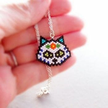 A Catlike Flair .  Make a charm necklace in under 120 minutes by beading with seed beads, beading thread, and beading needles. Creation posted by Bead Crumbs.  in the Jewelry section Difficulty: 3/5. Cost: 3/5.