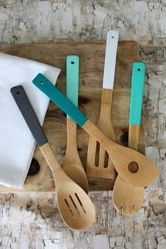 Paint your own kitchen utensils to create a little flair and add color to your kitchen. .  Free tutorial with pictures on how to make a kitchen utensil in under 60 minutes by decorating with wooden utensils, acrylic paint, and painter's tape. How To posted by Elizabeth R.  in the Art section Difficulty: Easy. Cost: Cheap. Steps: 9