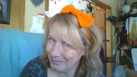 Crocheted Hair banded Bow.   .  Make a hair bow in under 45 minutes by crocheting with crochet needle and yarn. Inspired by bows and orange. Creation posted by Mistress Nora of Madness .  in the Yarncraft section Difficulty: Simple. Cost: No cost.