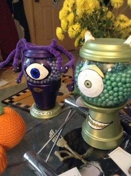 Candy filled Mike and Celia made from Clay Pots.  .  Make a Halloween decoration by decorating and  with paints, paints, and nail polish. Inspired by monsters, pixar, and snakes. Creation posted by Mistress Nora of Madness .  in the Decorating section Difficulty: 4/5. Cost: 3/5.