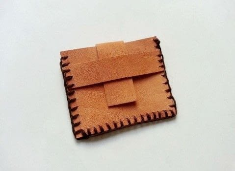 Leather Craft .  Free tutorial with pictures on how to sew a leather pouch in under 20 minutes by hand sewing with scissors, leather, and tapestry needle. How To posted by Muhaiminah Faiz.  in the Needlework section Difficulty: Simple. Cost: Cheap. Steps: 6