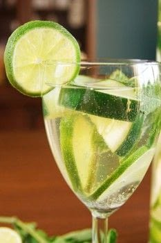 Simple, ultra refreshing sangria! .  Free tutorial with pictures on how to mix a sangria in 3 steps by mixing drinks with white wine, limes, and cucumber. Inspired by drinks. Recipe posted by Lindsay T.  in the Recipes section Difficulty: Easy. Cost: 3/5.