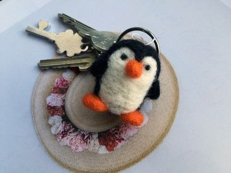 Penguin Charm - Needle Felting Basics .  Free tutorial with pictures on how to make a stitched charm in under 45 minutes by needleworking with felting needle, felting mat, and wool roving. Inspired by penguins. How To posted by Made by Me! Arts&Crafts.  in the Needlework section Difficulty: Easy. Cost: Cheap. Steps: 19