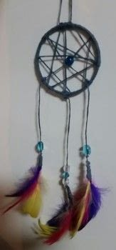 Dream catchers .  Make a dream catcher by yarncrafting and not sewing with metal hoop, string, and beads. Inspired by dreamcatchers. Creation posted by Carsmystical.  in the Other section Difficulty: Simple. Cost: Cheap.