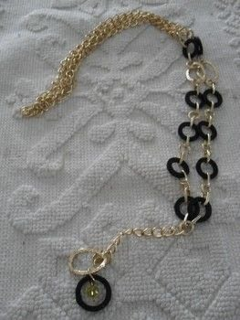 Fire Necklace .  Make a recycled necklace in under 90 minutes by jewelrymaking with necklace, trim, and bottle. Creation posted by Scompigli laboratorio di eco gioielleria.  in the Jewelry section Difficulty: Simple. Cost: 3/5.