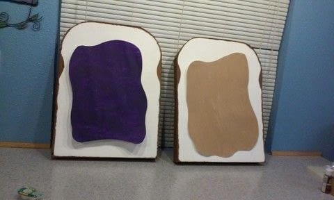 Cardboard bread with painted peanut butter & jelly costume .  Free tutorial with pictures on how to make a costume in under 120 minutes using cardboard, hot glue, and poster board. Inspired by costumes & cosplay and food. How To posted by kneellock.  in the Art section Difficulty: Simple. Cost: Cheap. Steps: 6