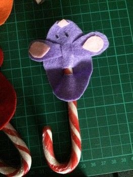 Cute Christmas Candy Cane Mice Decorations .  Free tutorial with pictures on how to make a mouse plushie in under 10 minutes using scissors, felt, and beads. Inspired by christmas, mice, and candy canes. How To posted by Lisa S.  in the Other section Difficulty: Simple. Cost: Cheap. Steps: 6