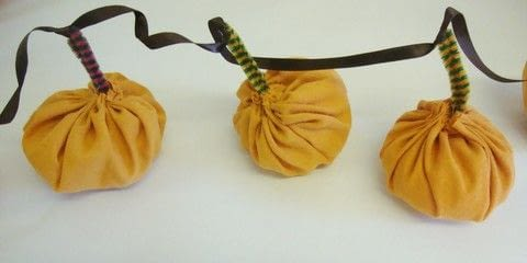 A super cute and easy pumpkin garland you can re-use again and again. .  Free tutorial with pictures on how to make a hanging garland in under 90 minutes using fabric, needle and thread, and pipe cleaners. Inspired by pumpkins. How To posted by Helen W.  in the Home + DIY section Difficulty: Easy. Cost: Cheap. Steps: 9