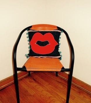 Kitschy Cool Lips Pillow! .  Make an embellished cushion in under 180 minutes by machine sewing with ribbon, fiberfill, and batting. Creation posted by The Sewing Maven.  in the Sewing section Difficulty: Simple. Cost: Cheap.