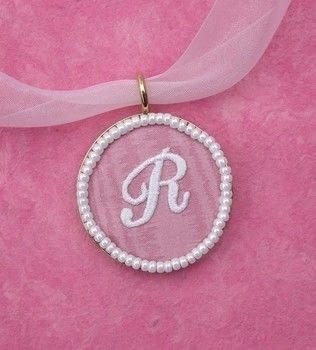 Use an iron-on letter to make this popular style of pendant. .  Free tutorial with pictures on how to make a fabric necklace in under 60 minutes by jewelrymaking with white glue, bezel, and seed beads. How To posted by Terry R.  in the Jewelry section Difficulty: Easy. Cost: Cheap. Steps: 7