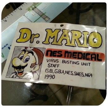 Doctor needs a medical badge STAT! .  Free tutorial with pictures on how to make a costume in under 45 minutes by drawing with shrinky dink plastic, scissors, and pencil. Inspired by super mario, costumes & cosplay, and doctors. How To posted by gypsie_jay.  in the Other section Difficulty: Simple. Cost: Cheap. Steps: 3