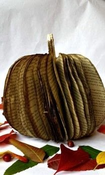 Have an old book lying around?  Make it into a decorative fall pumpkin! .  Free tutorial with pictures on how to make a piece of book art in under 120 minutes by papercrafting with paper, hot glue, and book. Inspired by halloween and pumpkins. How To posted by destinationdecoration.  in the Papercraft section Difficulty: 3/5. Cost: Absolutley free. Steps: 13