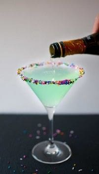 This drink is unapologetically girly with champage, cake vodka, Hpnotiq, and plenty of sprinkles. .  Free tutorial with pictures on how to mix a martini in under 4 minutes by mixing drinks with sprinkles, vodka, and hpnotiq. Recipe posted by saltandlavender.  in the Recipes section Difficulty: Easy. Cost: 4/5. Steps: 2