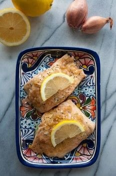 Quick & easy baked salmon with lemon shallot butter. .  Free tutorial with pictures on how to cook a salmon dish in under 20 minutes by cooking and baking with salmon, olive oil, and pepper. Recipe posted by saltandlavender.  in the Recipes section Difficulty: Easy. Cost: 3/5. Steps: 6