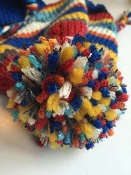 Use up your yarn stash to make this colorful ear flap hat .  Free tutorial with pictures on how to make a hat in 10 steps by knitting How To posted by natashaprice.  in the Yarncraft section Difficulty: Simple. Cost: No cost.