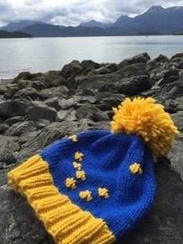 Plush and slouchy hat with a huge pompom .  Free tutorial with pictures on how to make a hat in 7 steps by knitting Inspired by space. How To posted by natashaprice.  in the Yarncraft section Difficulty: Simple. Cost: No cost.