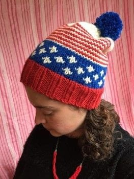 Show your patriotism with this awesome winter hat! .  Free tutorial with pictures on how to make a hat in 7 steps by knitting Inspired by america. How To posted by natashaprice.  in the Yarncraft section Difficulty: 3/5. Cost: No cost.