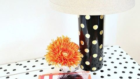 Makeover a thrift store lamp into a Kate Spade lamp! .  Free tutorial with pictures on how to make a lamp / lampshade in under 60 minutes by decorating, embellishing, potting, stamping, and not sewing with gloss, lamp, and foil. Inspired by kate spade. How To posted by Mark Montano.  in the Home + DIY section Difficulty: Easy. Cost: Cheap. Steps: 3