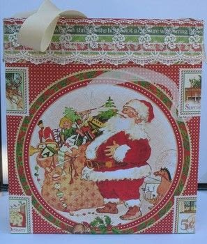 When a small gift bag just isn't the right size .  Free tutorial with pictures on how to make a gift bag in under 30 minutes by papercrafting with pattern paper, scoring board, and paper trimmer. Inspired by santa claus. How To posted by Peg R.  in the Papercraft section Difficulty: Easy. Cost: 3/5. Steps: 11