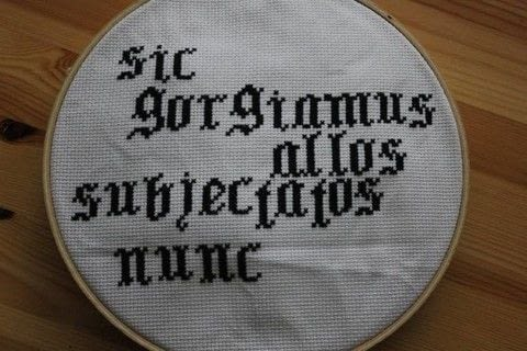 It's terrible movie Latin, but at least it looks cool.  .  Free tutorial with pictures on how to cross stitch art in 1 step by cross stitching with aida cloth, embroidery thread, and embroidery hoop. How To posted by MagicalGirlMaya.  in the Needlework section Difficulty: Easy. Cost: Cheap.