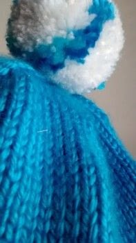 Let it go! Let it goooo!  ♪ ♪ ♪ .  Make a beanie by cross stitching, embroidering, and knitting with yarn, knitting needles, and needle. Inspired by disney, snowflakes, and frozen. Creation posted by Nancy!.  in the Yarncraft section Difficulty: Simple. Cost: Cheap.