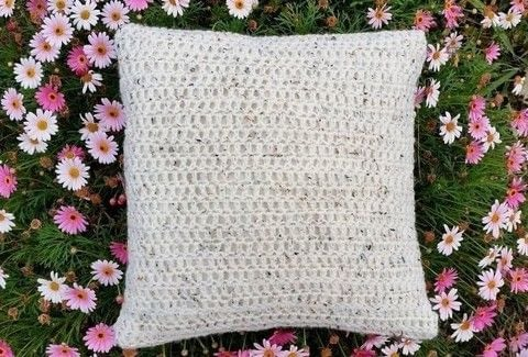 Have fun making this luxurious chunky cushion cover .  Free tutorial with pictures on how to stitch a knit or crochet cushion in 7 steps using yarn, cushion inner, and crochet hook. How To posted by Alana S.  in the Yarncraft section Difficulty: Simple. Cost: Cheap.
