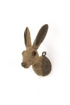 Animal Heads .  Free tutorial with pictures on how to make a taxidermy mount in 19 steps by knitting with wool, yarn, and crochet hook. Inspired by rabbits. How To posted by GMC Group.  in the Yarncraft section Difficulty: 3/5. Cost: Cheap.