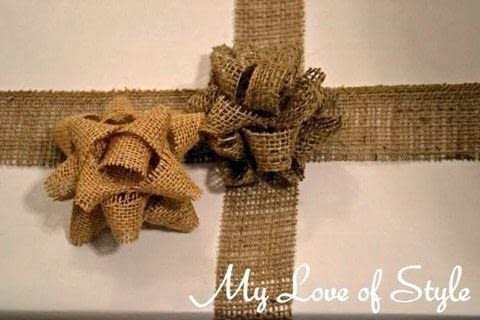 Easy DIY Burlap Gift Bow Tutorial .  Free tutorial with pictures on how to make a gift bow in under 15 minutes using burlap, hot glue gun, and scissors. Inspired by gifts and christmas. How To posted by Jessica {My Love of Style}.  in the Home + DIY section Difficulty: Easy. Cost: Absolutley free. Steps: 8