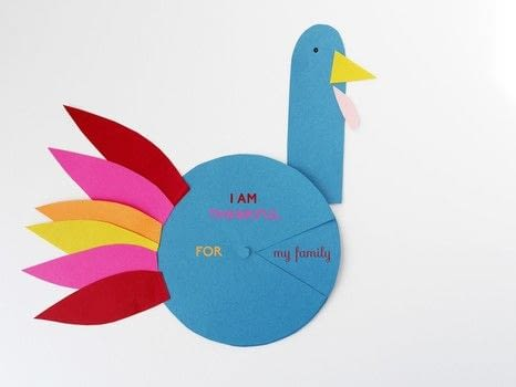 I AM THANKFUL FOR! PAPER CRAFT TURKEY SPINNER .  Free tutorial with pictures on how to make a paper model in under 30 minutes by papercrafting with scissors, glue, and hole punch. Inspired by thanksgiving and turkeys. How To posted by La maison de Loulou.  in the Papercraft section Difficulty: Easy. Cost: Absolutley free. Steps: 3