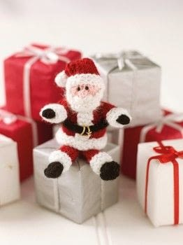Mini Knitted Christmas .  Free tutorial with pictures on how to make a character plushie in under 180 minutes by knitting with yarn, yarn, and beads. Inspired by christmas and santa claus. How To posted by Search Press.  in the Yarncraft section Difficulty: Simple. Cost: Cheap. Steps: 5
