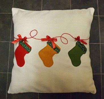Christmas Cushion .  Make an embellished cushion in under 120 minutes by machine sewing with fabric, embroidery thread, and bells. Inspired by christmas. Creation posted by PixieFey.  in the Sewing section Difficulty: Easy. Cost: Absolutley free.
