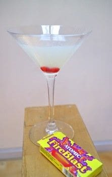 A classic gin martini with a candy fire twist! .  Free tutorial with pictures on how to mix a martini in under 5 minutes by mixing drinks with gin, simple syrup, and vermouth. Recipe posted by Cat Morley.  in the Recipes section Difficulty: Simple. Cost: Cheap. Steps: 4