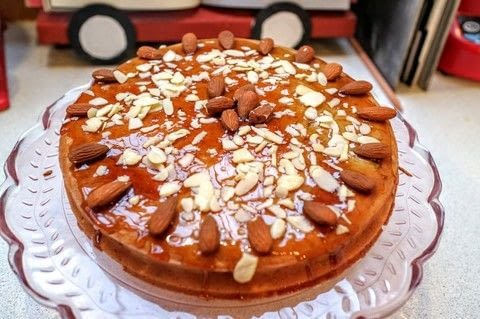 Almond & apple cake topped with a sweet gin syrup and almonds! .  Free tutorial with pictures on how to bake an apple cake in under 45 minutes by cooking and baking with eggs, brown sugar, and ground almonds. Recipe posted by Cat Morley.  in the Recipes section Difficulty: Simple. Cost: Cheap. Steps: 10