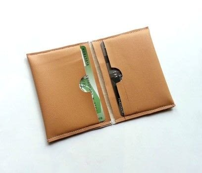 Vinyl Craft .  Free tutorial with pictures on how to make a pouch, purse or wallet in under 30 minutes by sewing with scissors, thread, and sewing machine. How To posted by Muhaiminah Faiz.  in the Needlework section Difficulty: Simple. Cost: 3/5. Steps: 4