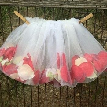 Easy DIY Girl's Tutu is a perfect sewing project for a beginner .  Free tutorial with pictures on how to make a tutu in under 60 minutes by sewing and dressmaking with tulle, elastic, and petals. How To posted by adwildflower.  in the Sewing section Difficulty: Easy. Cost: No cost. Steps: 6