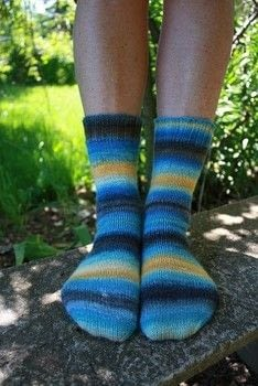 A super simple magic loop sock pattern written with handspun or your favorite fingering weight yarn in mind. .  Free tutorial with pictures on how to make a sock in 5 steps by knitting with fingering weight yarn, double pointed knitting needles, and tapestry needle. How To posted by Sand And Sky Creations.  in the Yarncraft section Difficulty: Simple. Cost: Cheap.