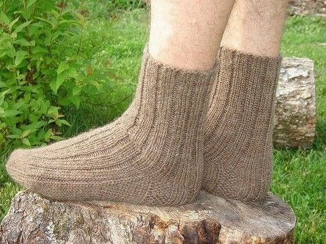 My husband really loves hand knit socks which is a good thing because I love knitting them! .  Free tutorial with pictures on how to make a sock in 6 steps by knitting with worsted weight yarn, needles, and tapestry needle. How To posted by Sand And Sky Creations.  in the Yarncraft section Difficulty: Simple. Cost: 3/5.