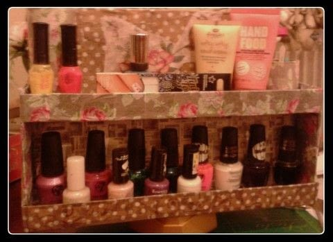 A creative way to store your nail varnish - with handmade swivel action! .  Free tutorial with pictures on how to make a storage unit in 14 steps by decorating and decoupaging with chocolate box, decoupage glue, and cardboard tube. How To posted by artiTan.  in the Other section Difficulty: Simple. Cost: Absolutley free.