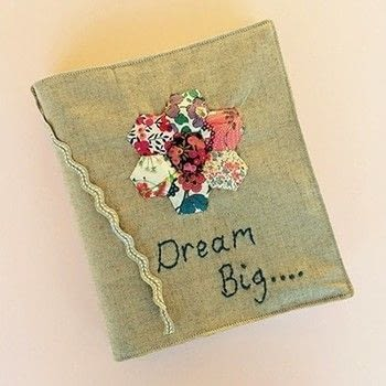 A neat and nifty personalised notebook cover! .  Free tutorial with pictures on how to make a fabric book cover in under 180 minutes by sewing with thread, embroidery thread, and measuring tape. How To posted by Lauren G.  in the Sewing section Difficulty: Simple. Cost: 3/5. Steps: 15