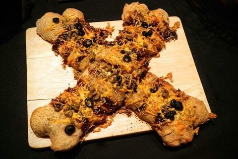 Tear into a cheese, herb and olive bread shaped like bones on Halloween .  Free tutorial with pictures on how to bake a tear and share bread in under 25 minutes by cooking and baking with bread flour, baking soda, and salt. Inspired by halloween. Recipe posted by Cat Morley.  in the Recipes section Difficulty: Simple. Cost: Cheap. Steps: 7