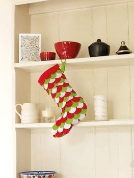 Christmas Stockings .  Free tutorial with pictures on how to make a Christmas stocking in under 120 minutes by sewing with fabric, felt, and felt. Inspired by christmas. How To posted by Search Press.  in the Sewing section Difficulty: Simple. Cost: Cheap. Steps: 9